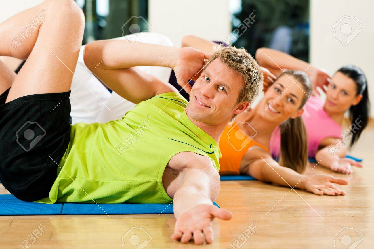 Sit-ups in gym for fitness Stock Photo - 9415547
