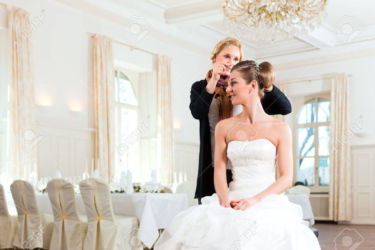 Stylist Pinning Up A Bride\'s Hairstyle Before The Wedding Stock ...