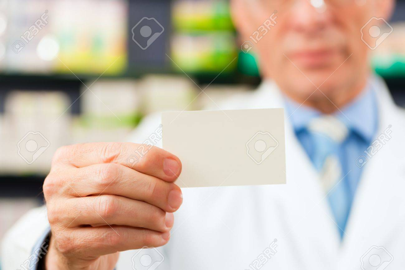 Pharmacist With Business Card In Pharmacy; Focus On Card Stock Photo ...