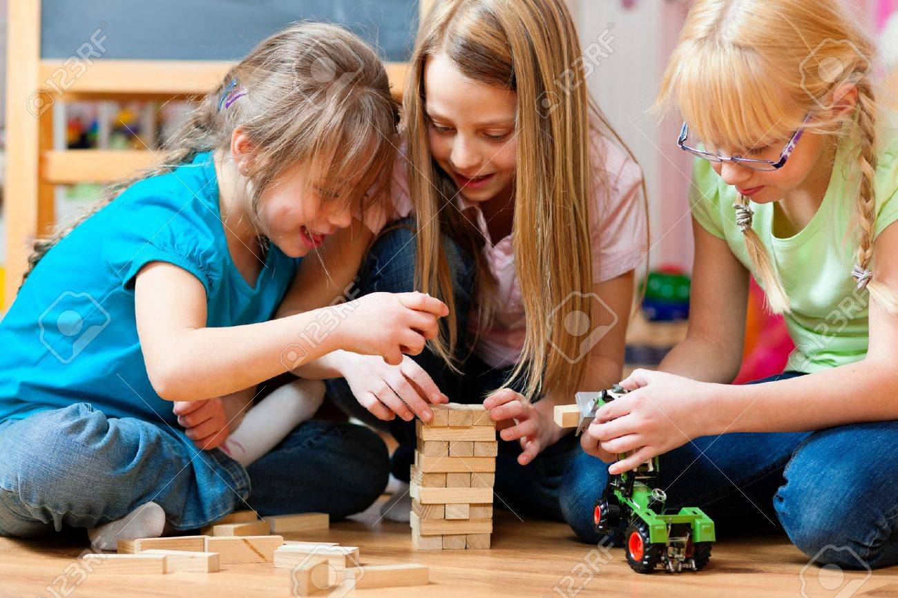 Children - sisters - playing at home with bricks Stock Photo - 10021021