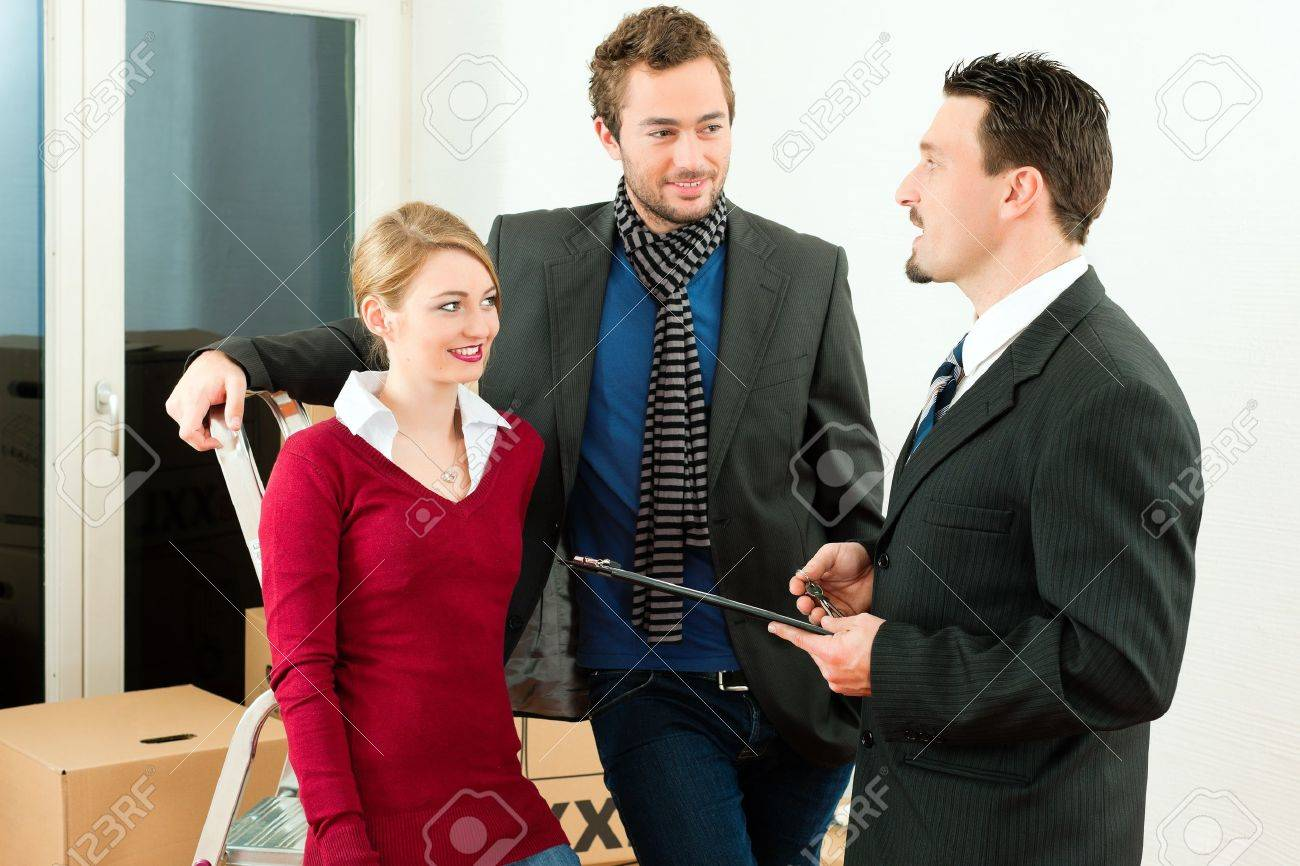 Young couple buying or renting a home or apartment, they are meeting the owner or real estate broker negotiating details Stock Photo - 10269899