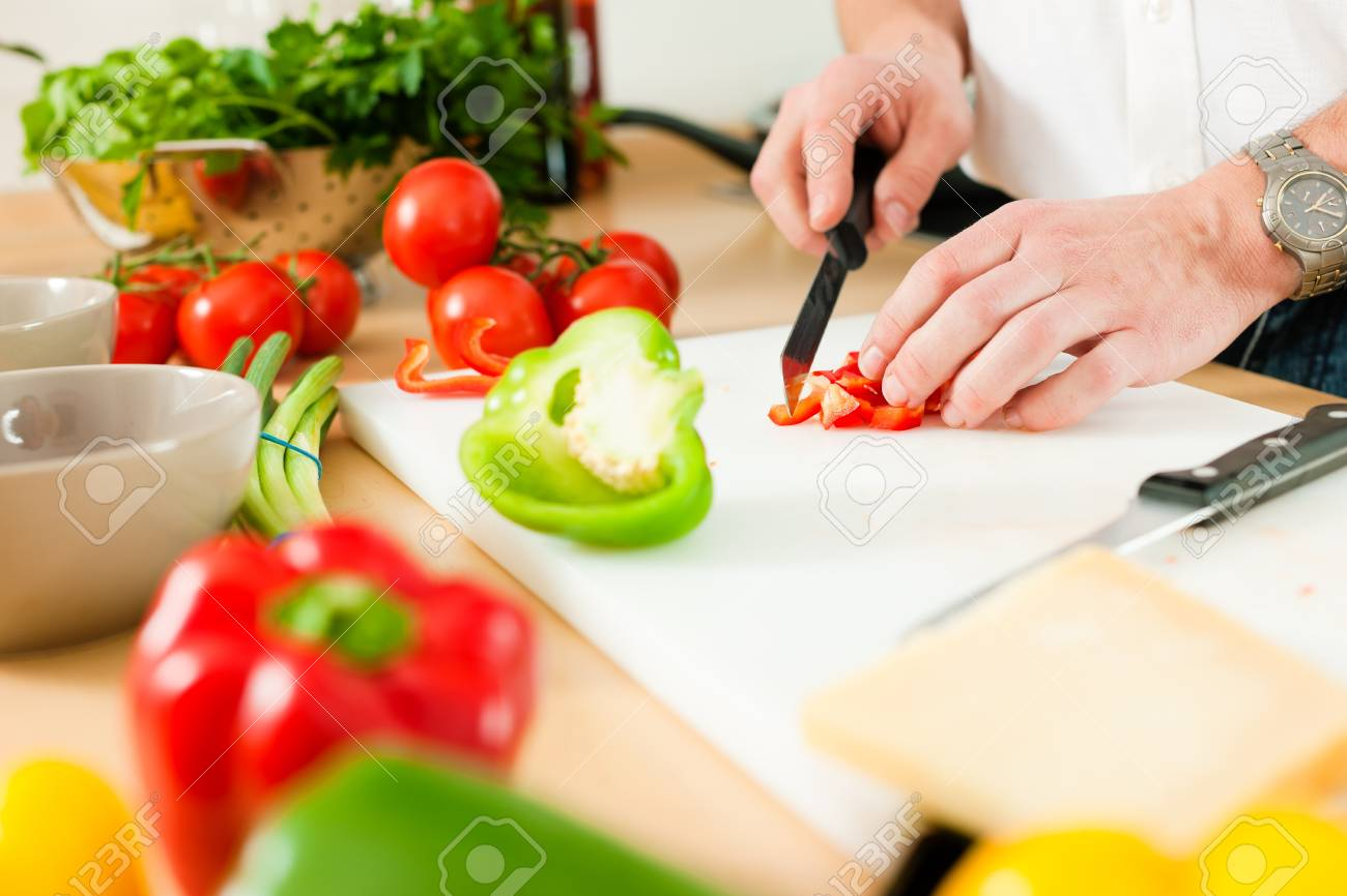 Man in the kitchen – only hands to be seen – is preparing the vegetables for dinner or lunch Stock Photo - 10269913