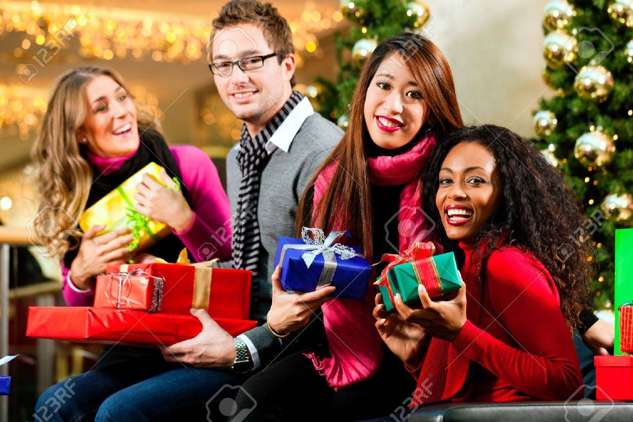 Black People Christmas Pictures.Diversity Group Of Four People Caucasian Black And Asian