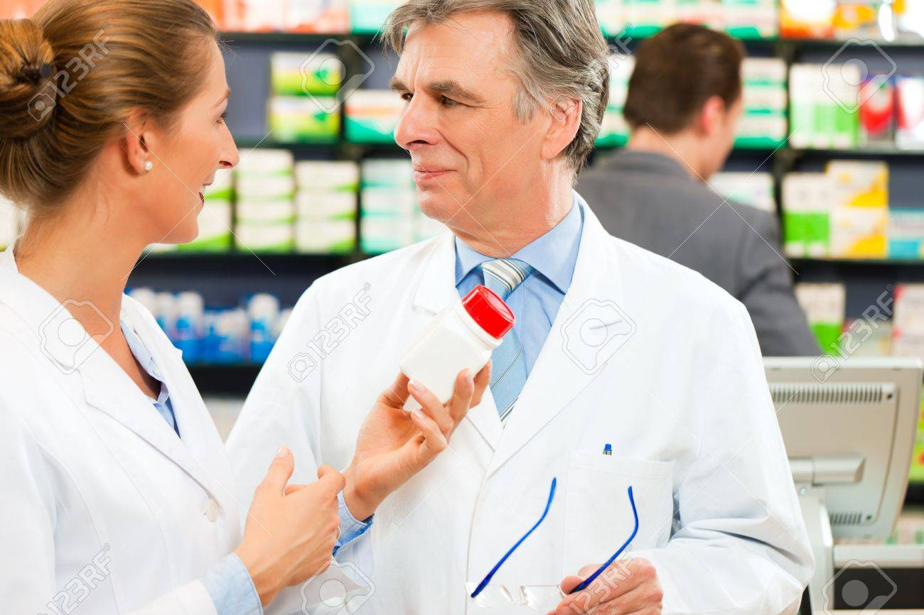 Two pharmacists in pharmacy consulting Stock Photo - 10427977