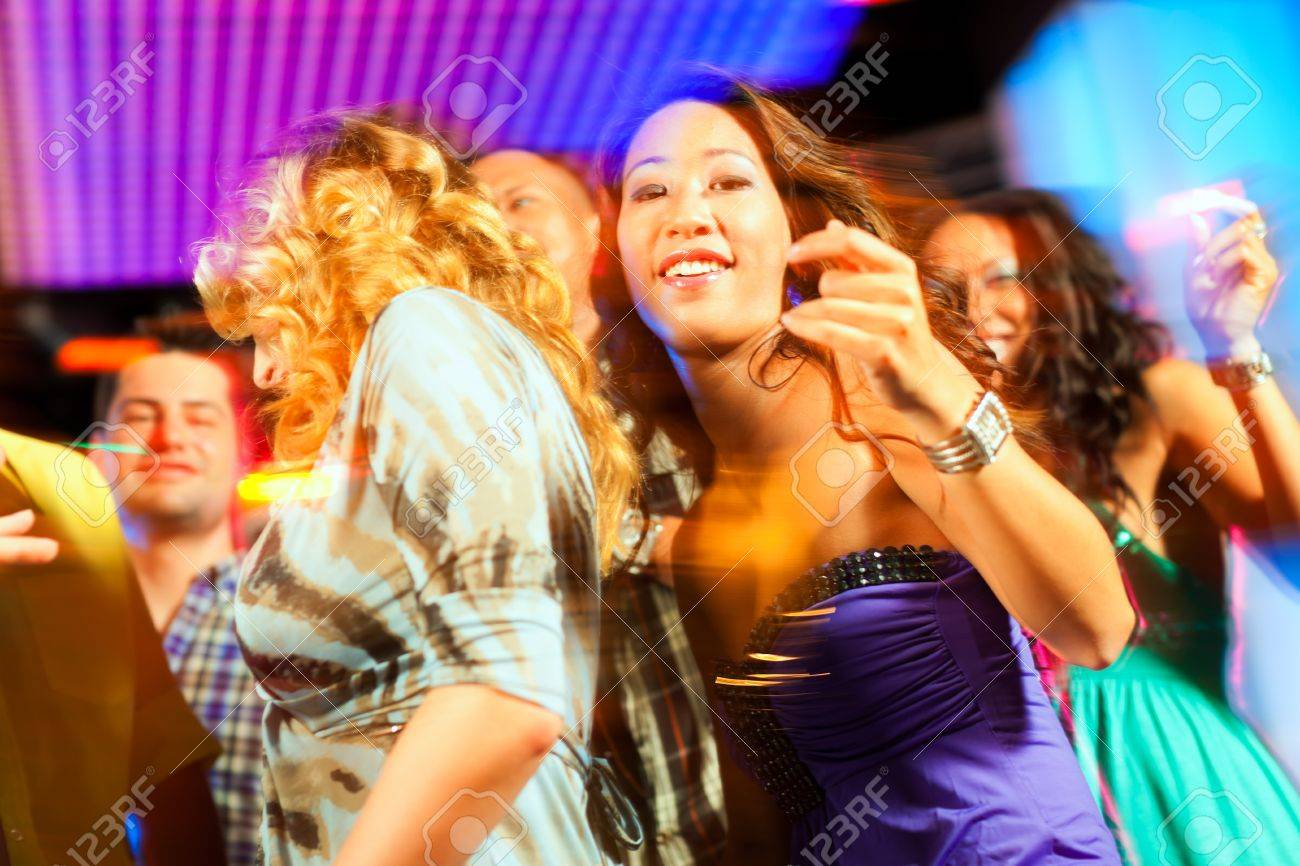 Group of party people - men and women - dancing in a disco club to the music Stock Photo - 10448767