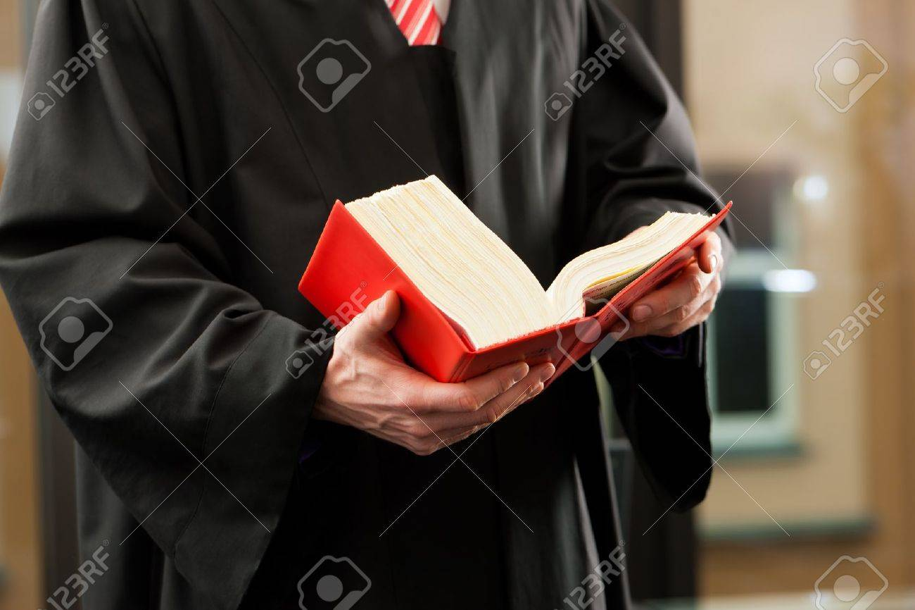 Lawyer with civil law code in a court room, close-up, only torso to be seen Stock Photo - 11193772