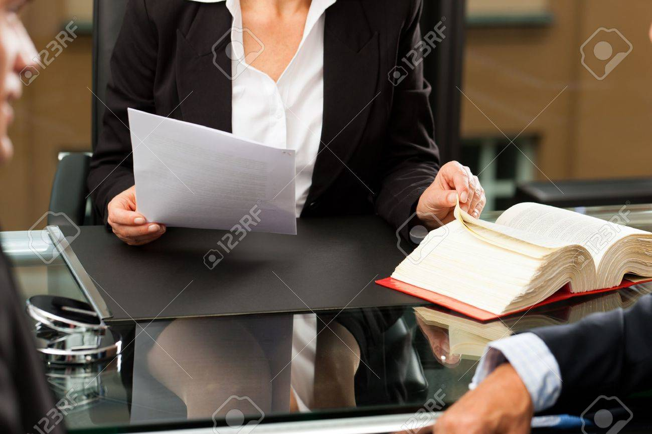 Mature female lawyer or notary with client in her office for counseling Stock Photo - 11193739