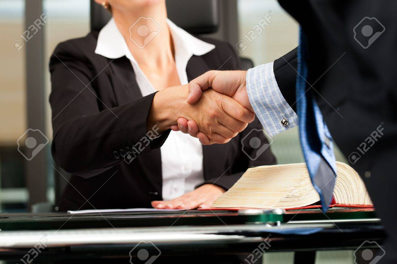Mature female lawyer or notary with client in her office - handshake Stock Photo - 11193766