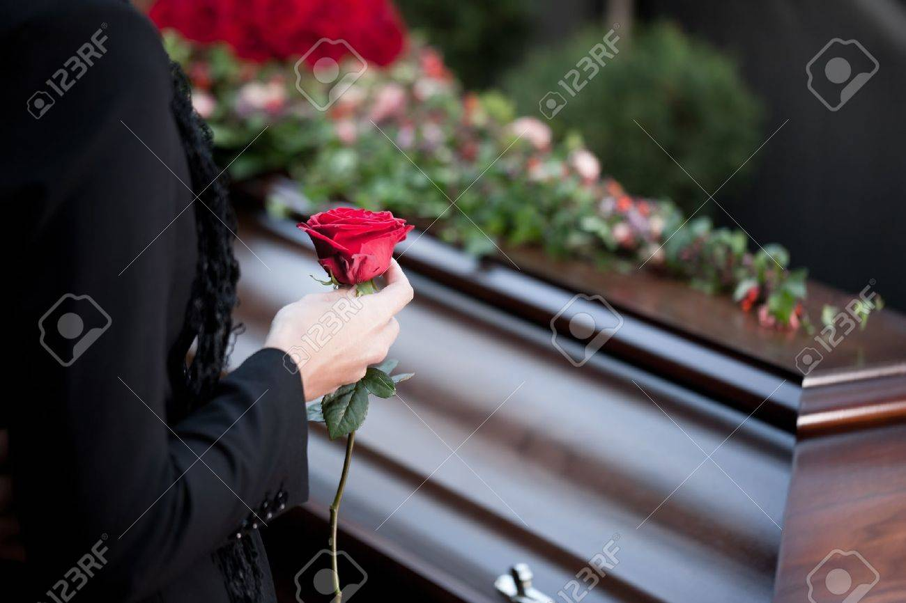 Religion, death and dolor  - funeral and cemetery; funeral with coffin Stock Photo - 11193765