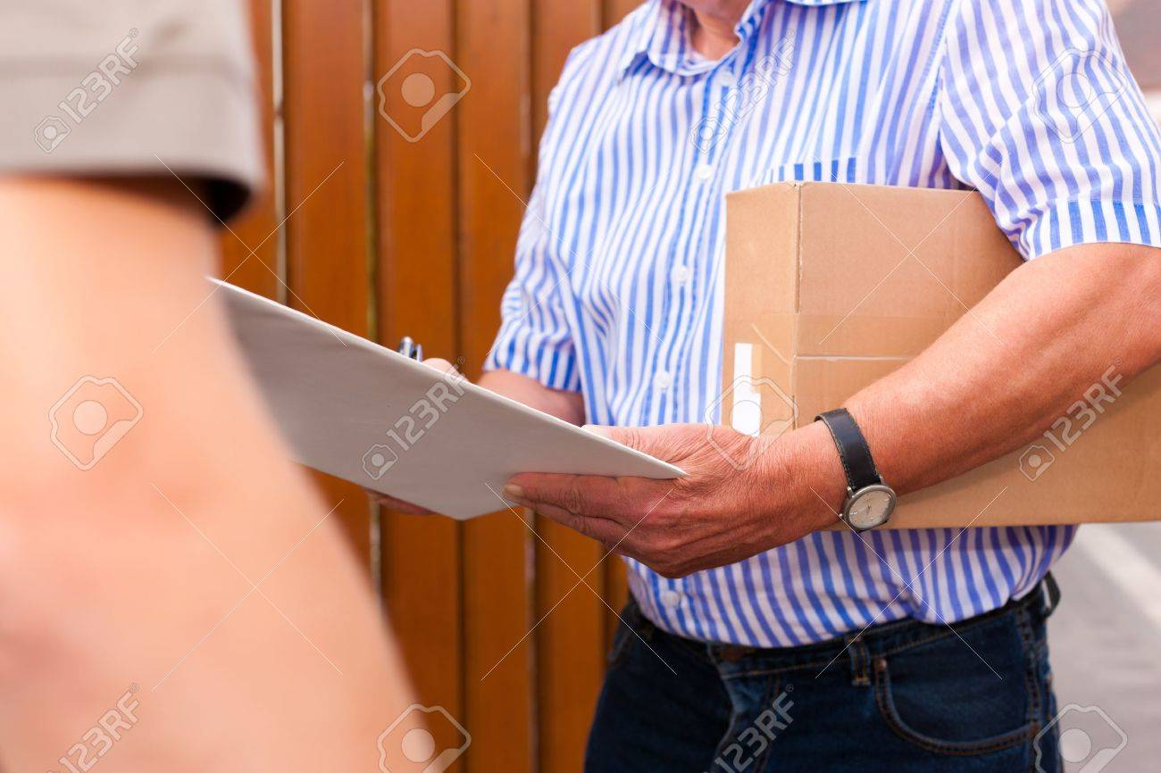 Postal service - delivery of a package through a delivery service; the customer receipt the delivery Stock Photo - 11530259