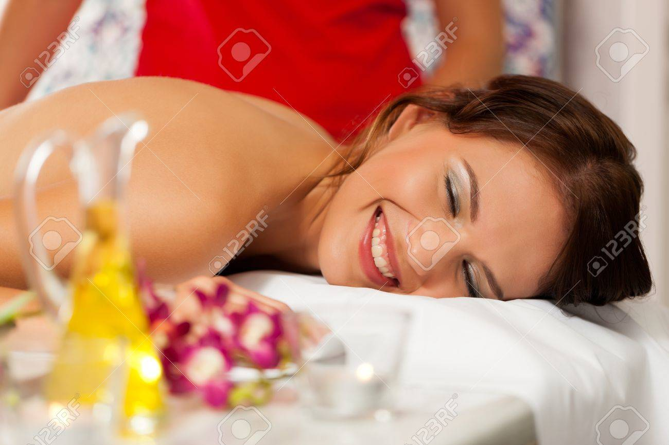 Wellness - woman getting massage in Spa; it is a traditional back massage Stock Photo - 11530223
