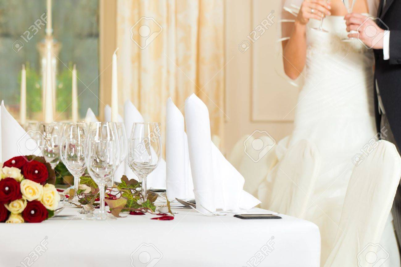 Wedding table at a wedding feast decorated with bridal bouquet Stock Photo - 11840609