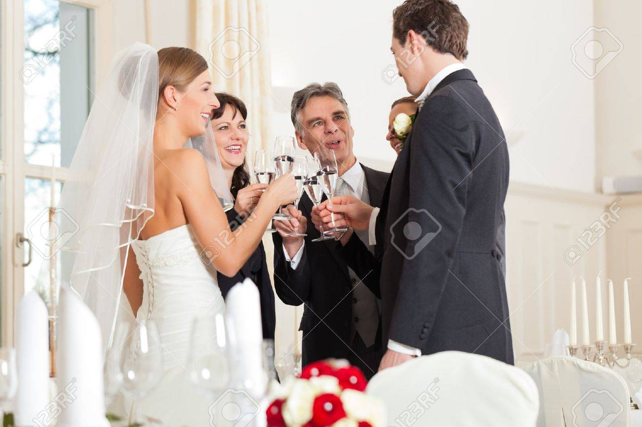 Wedding party bride, groom and bride father clinking glasses with sparkling wine Stock Photo - 11840622