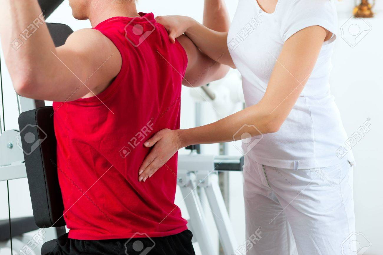 Patient at the physiotherapy making physical exercises with his therapist Stock Photo - 12466041