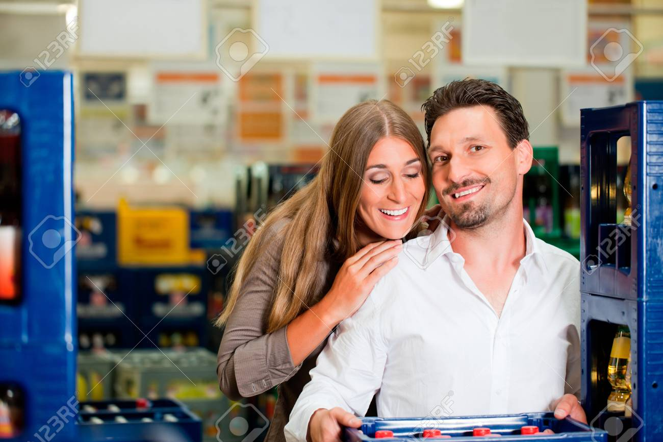 Young couple in supermarket buying beverages together Stock Photo - 12443622