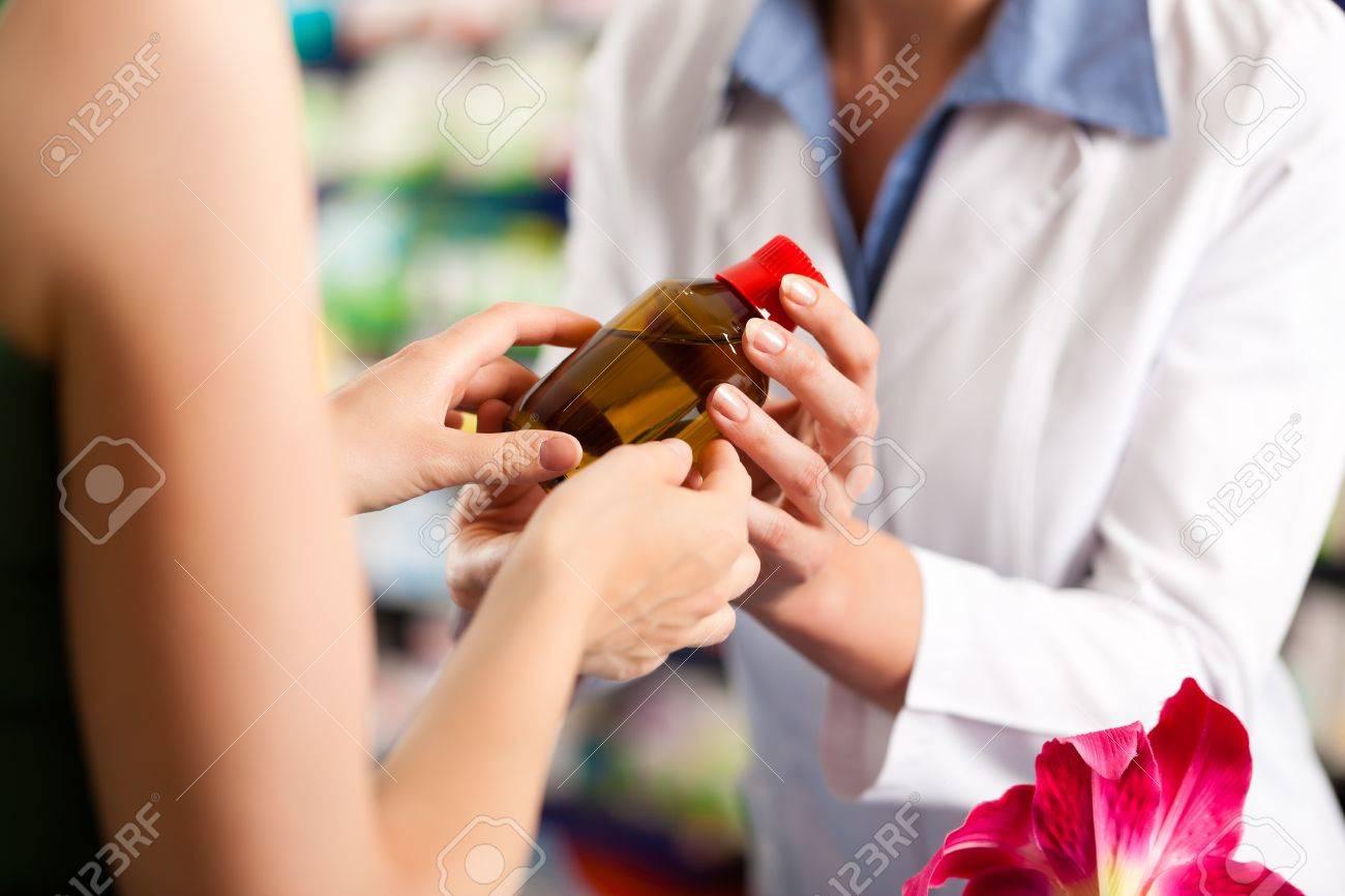 Female pharmacist consulting a female customer in her pharmacy Stock Photo - 12903216