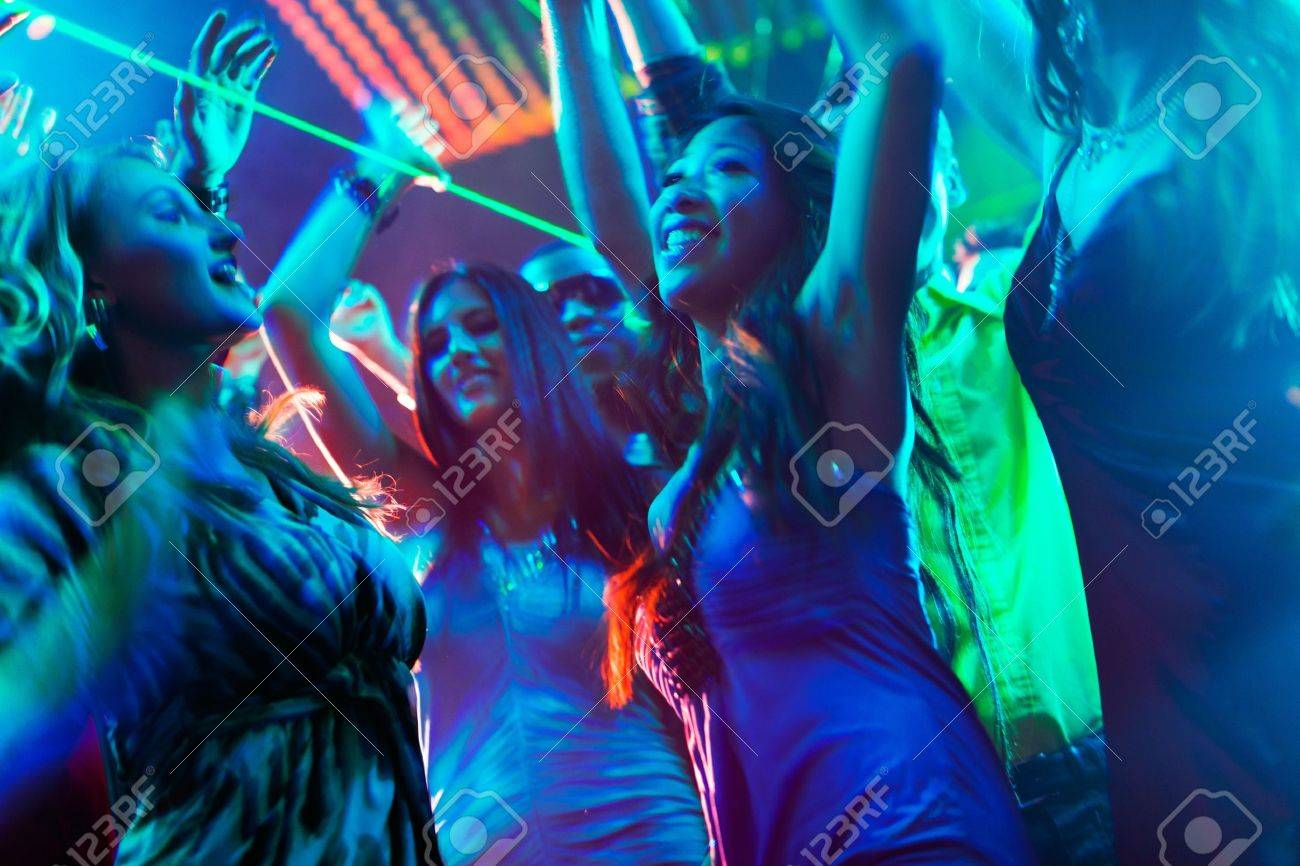 Group of party people - men and women - dancing in a disco club to the music Stock Photo - 13453072
