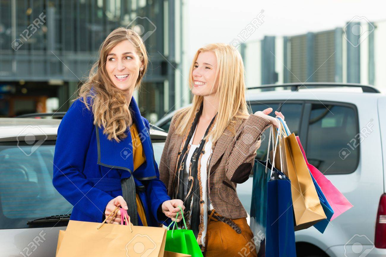 Two women were shopping in a mall or shopping centre and driving home now with their car Stock Photo - 13452945