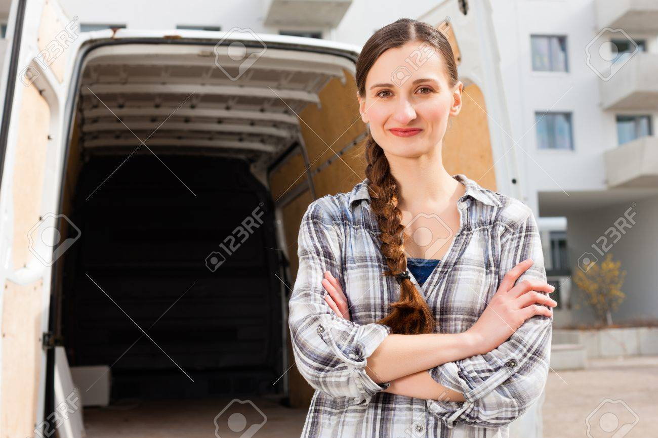 Young woman in front of moving truck, the van is still empty Stock Photo - 13503365
