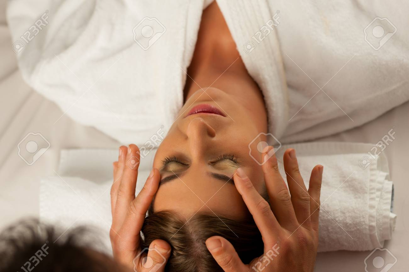 Young woman enjoying head massage or cosmetic treatment in Spa Stock Photo - 13708881