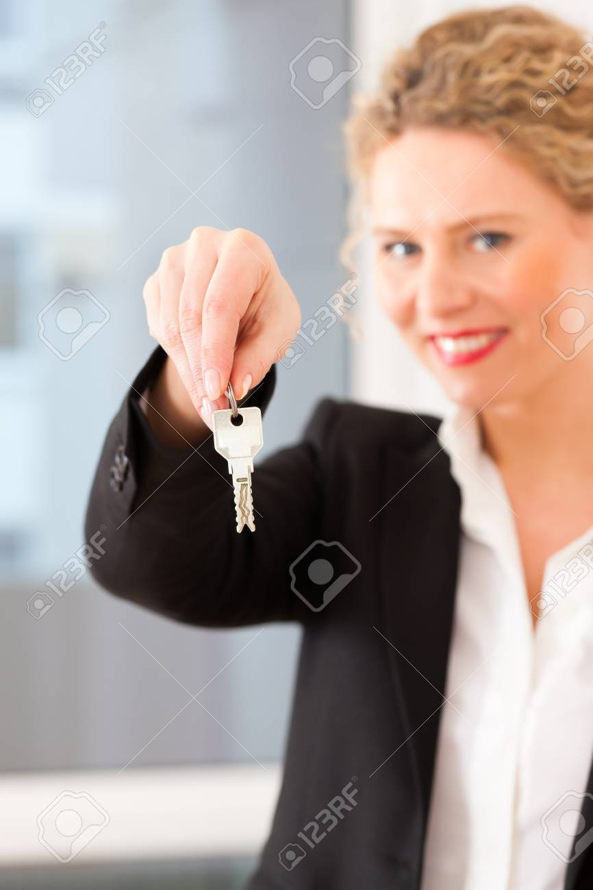 Young realtor is with keys in an apartment, it could be the tenant too Stock Photo - 13708823
