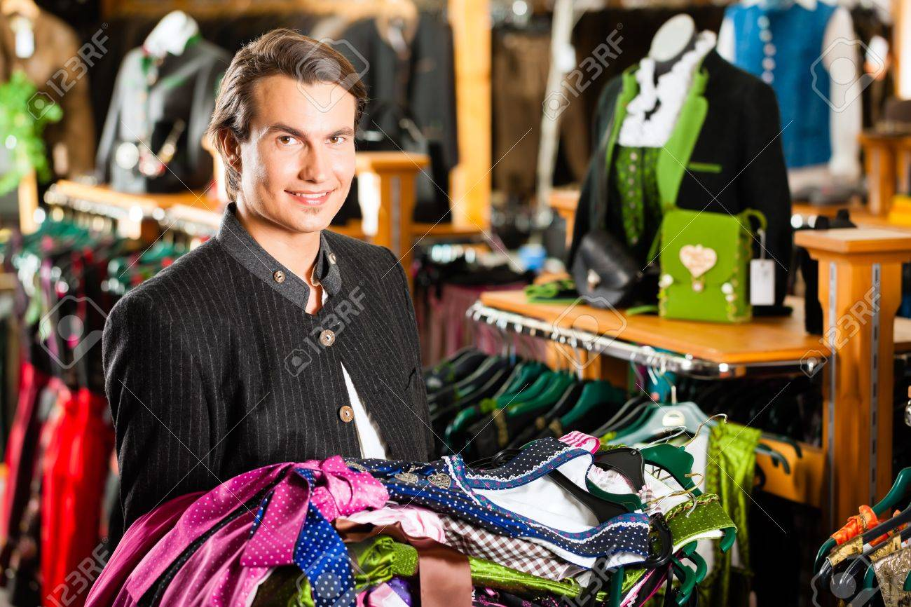 0920a6f44ba Stock Photo - Traditional clothes - young man is buying Tracht or dirndl in  a shop