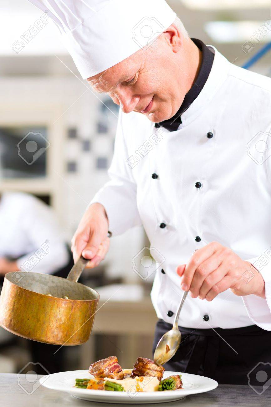 Chef Kitchen Chef In Hotel Or Restaurant Kitchen Cooking He Is Working On
