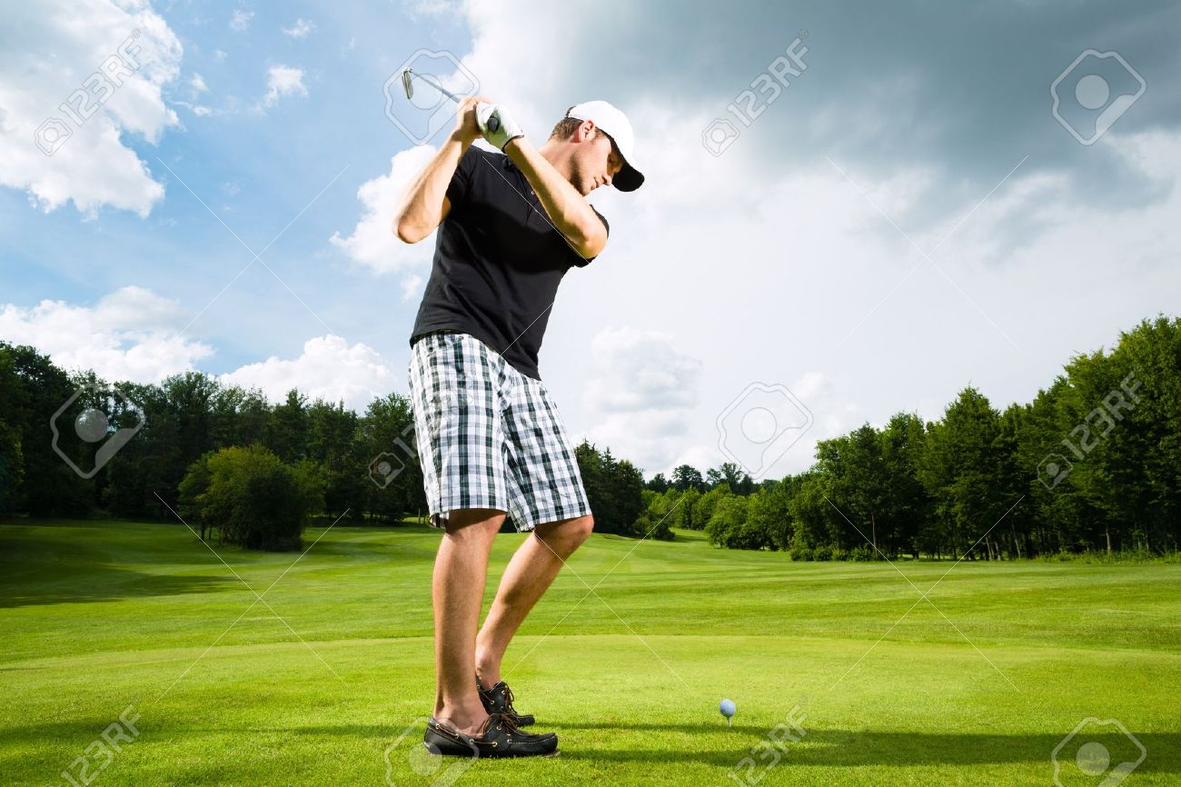 Young golf player on course doing golf swing, he presumably does exercise - 15678229