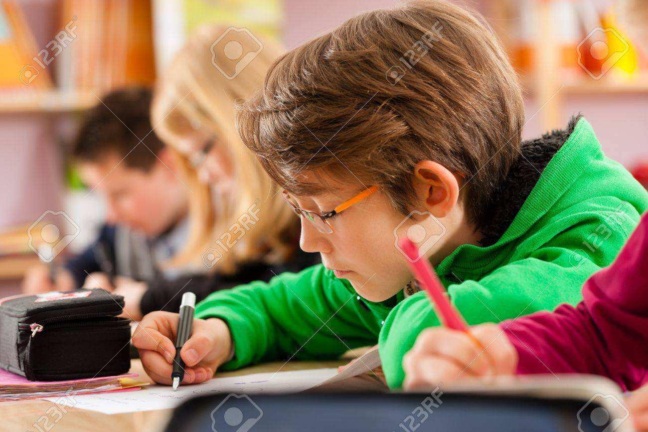 Education - Pupils at primary or elementary school doing their homework or having a school test Stock Photo - 15785053