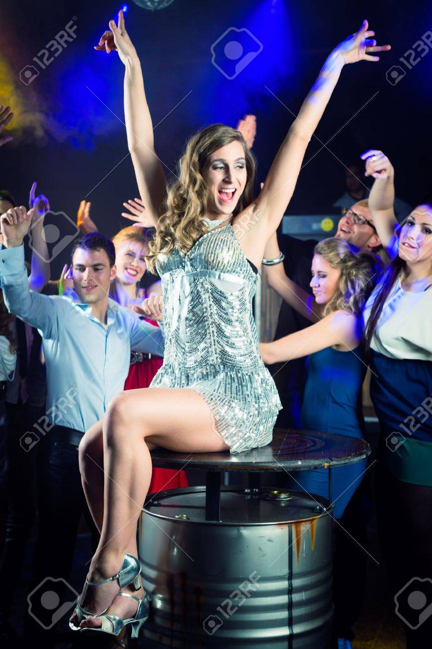 Young people dancing in club or disco and have party, the girls and boys, friends, having fun Stock Photo - 15784996