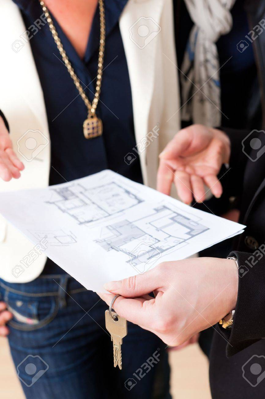 Young realtor explain ground plan to couple in an apartment Stock Photo - 16011511