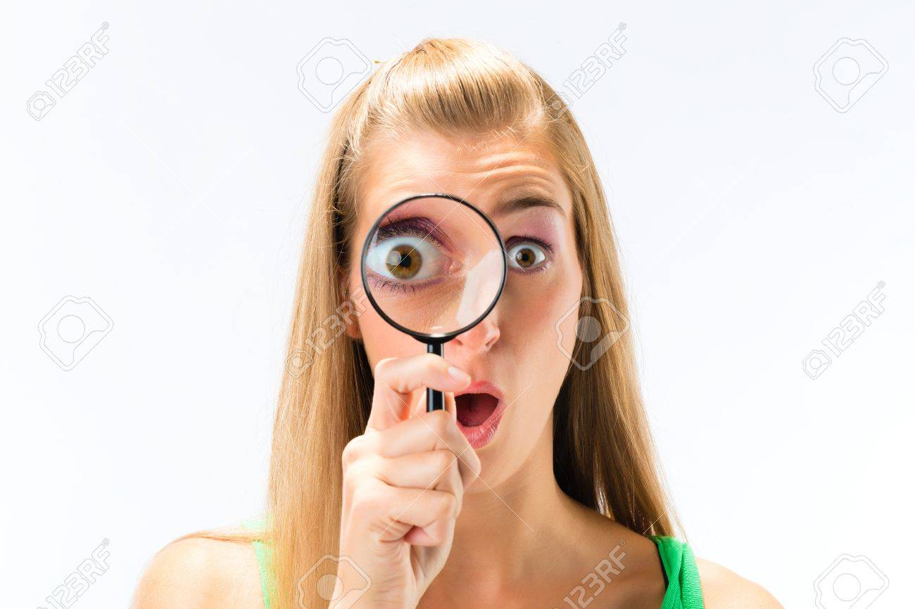 Woman looking through magnifying glass or loupe Stock Photo - 16882972