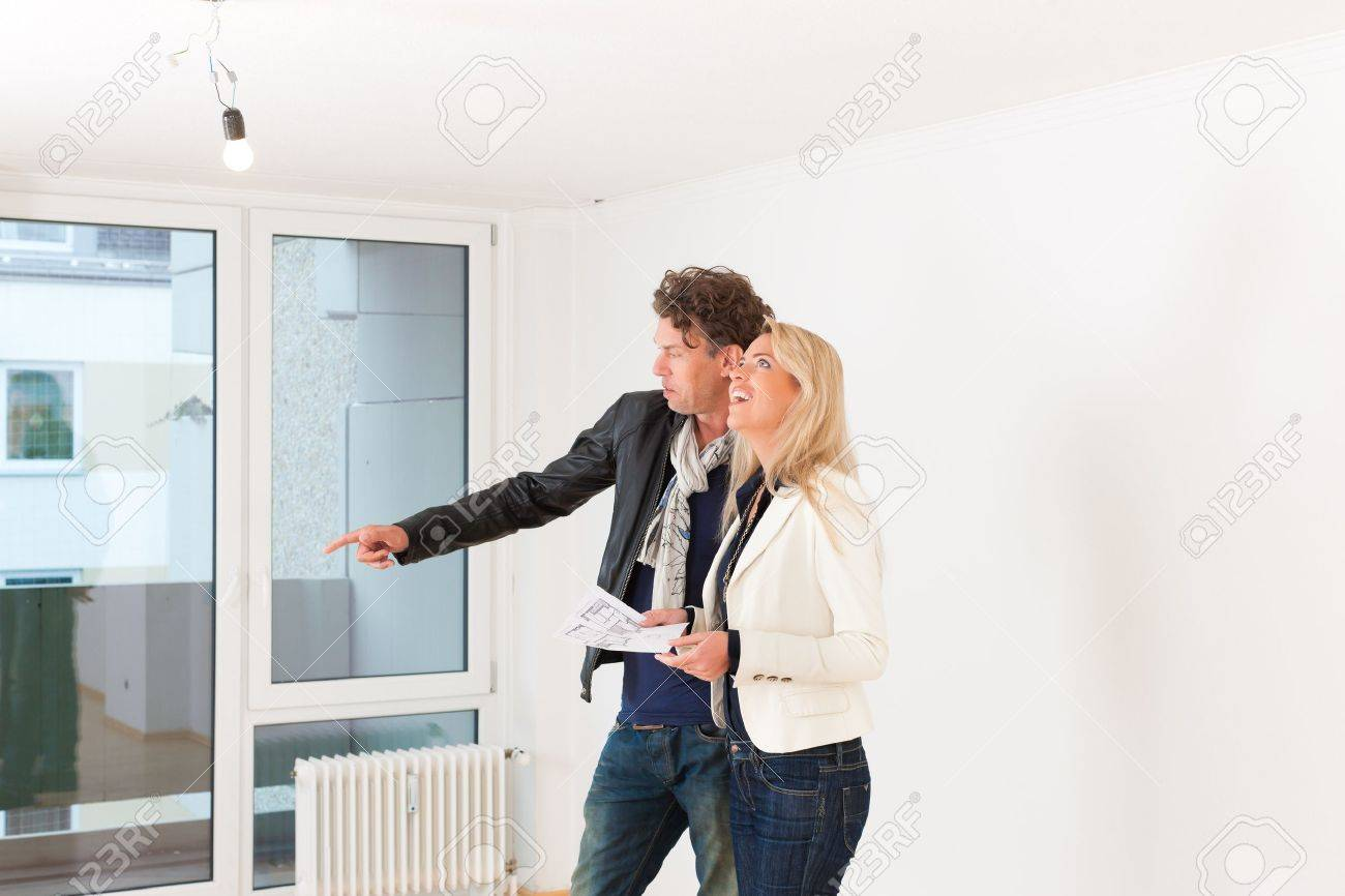 Real Estate Market   Young Couple Looking For Real Estate To Rent Or Buy An  Apartment