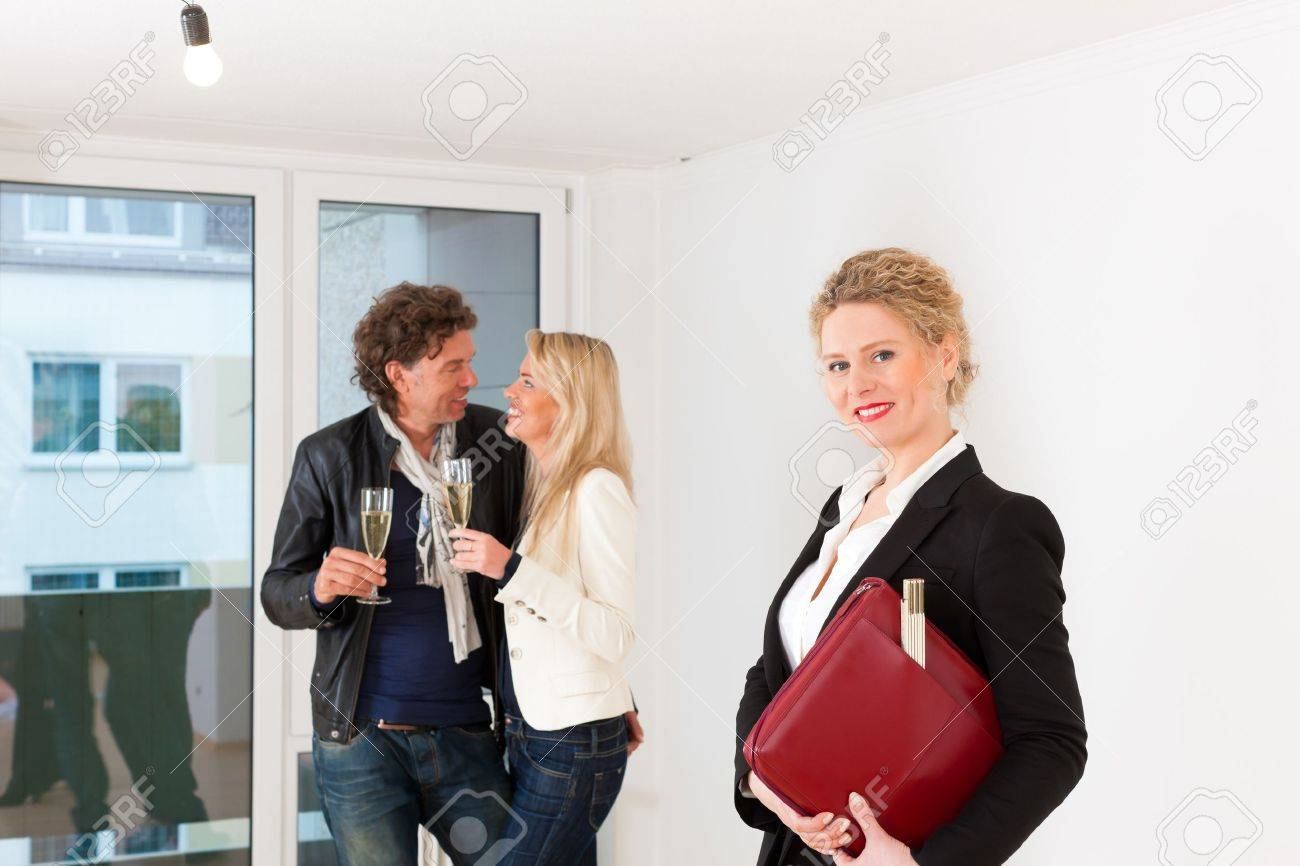 Real estate market - young couple looking for real estate to rent or buy an apartment Stock Photo - 17424856