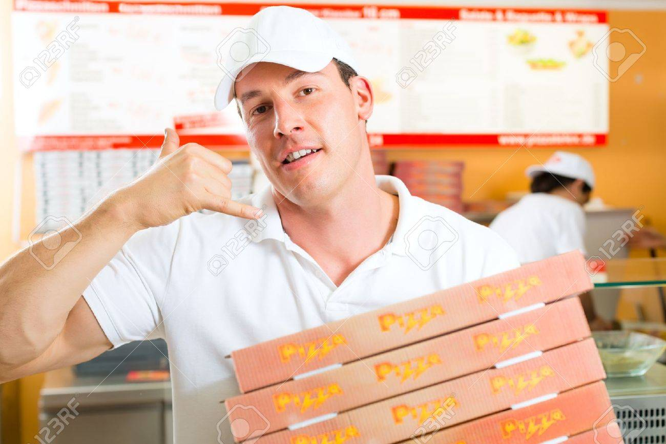 Man holding several pizza boxes in hand and asking you to order pizza for delivery Stock Photo - 17620250