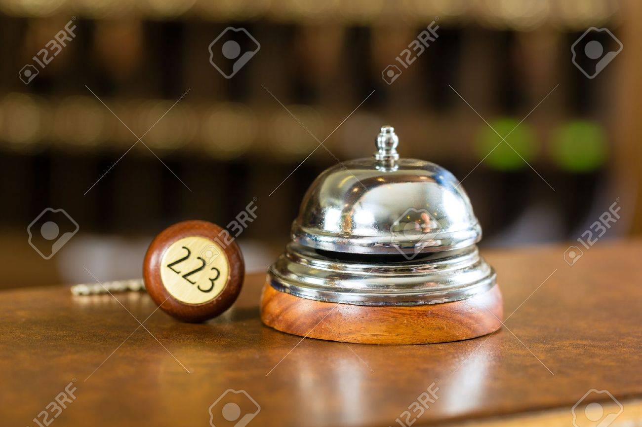 Reception - Hotel bell and key lying on the desk Stock Photo - 17798522