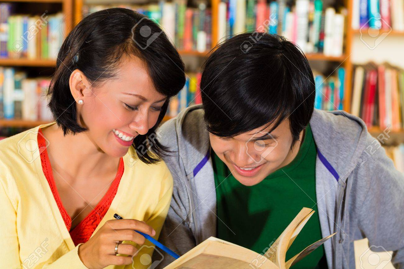 Students - Young Asian woman and man in library with laptop and book learn, they are a learning group Stock Photo - 18064084