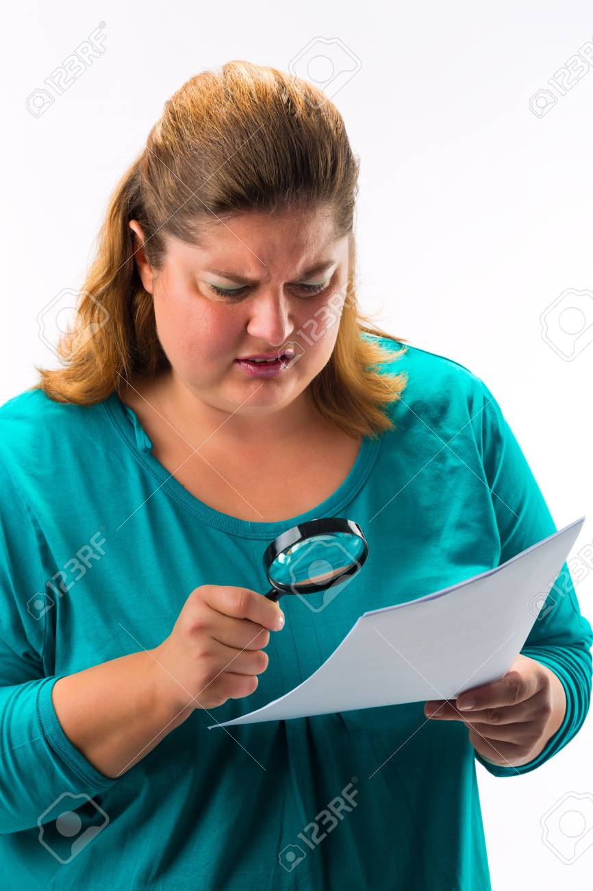 Woman looking through magnifying glass or loupe Stock Photo - 18230945