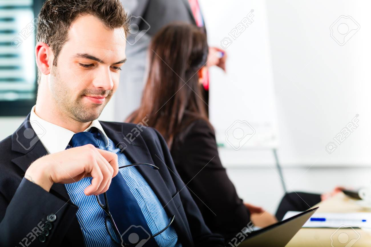 Business - businesspeople have a meeting with presentation in office, they negotiate a contract - Portrait of a businessman Stock Photo - 18344704