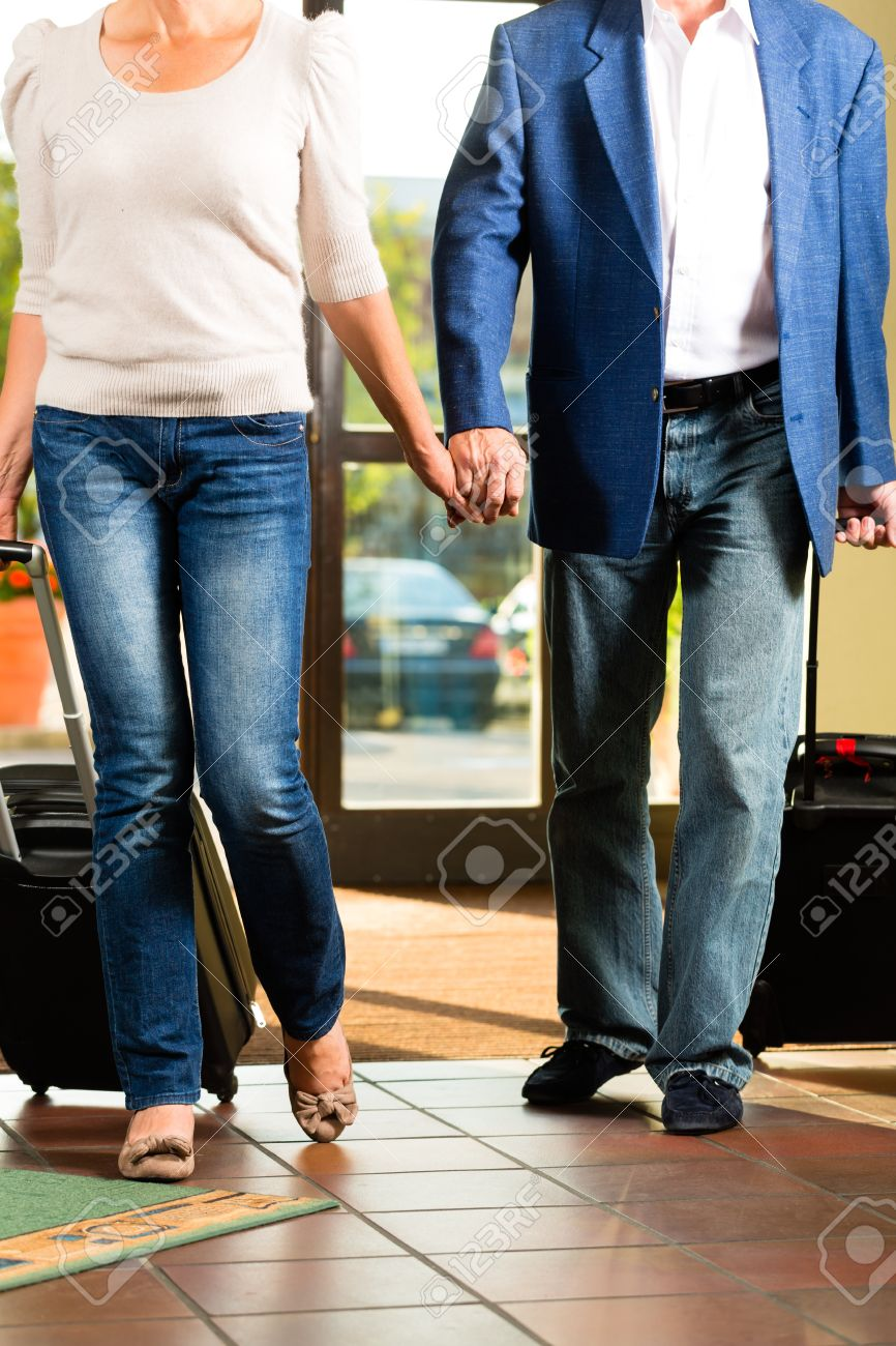 Senior man and woman - married couple - arriving at Hotel with their luggage Stock Photo - 18451877