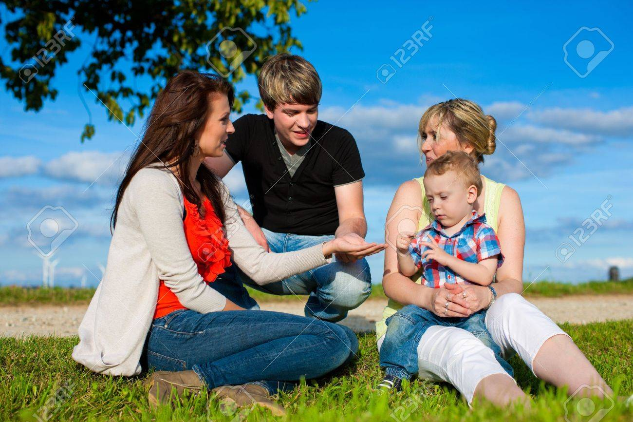 Family - Grandmother, mother, father and child sitting and playing in garden Stock Photo - 18908874