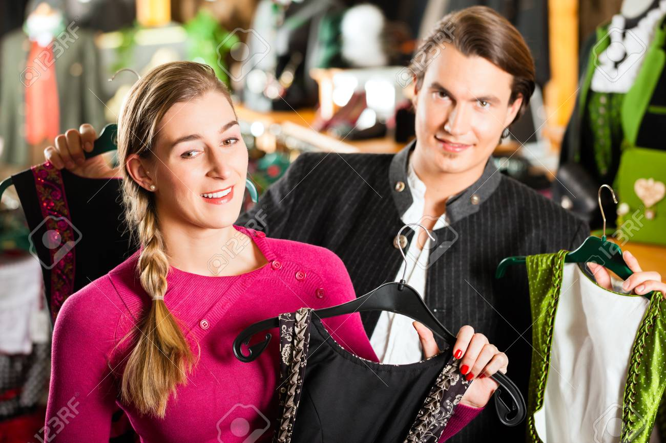 0085539f085 Stock Photo - Traditional clothes - young couple is buying Tracht or dirndl  in a shop