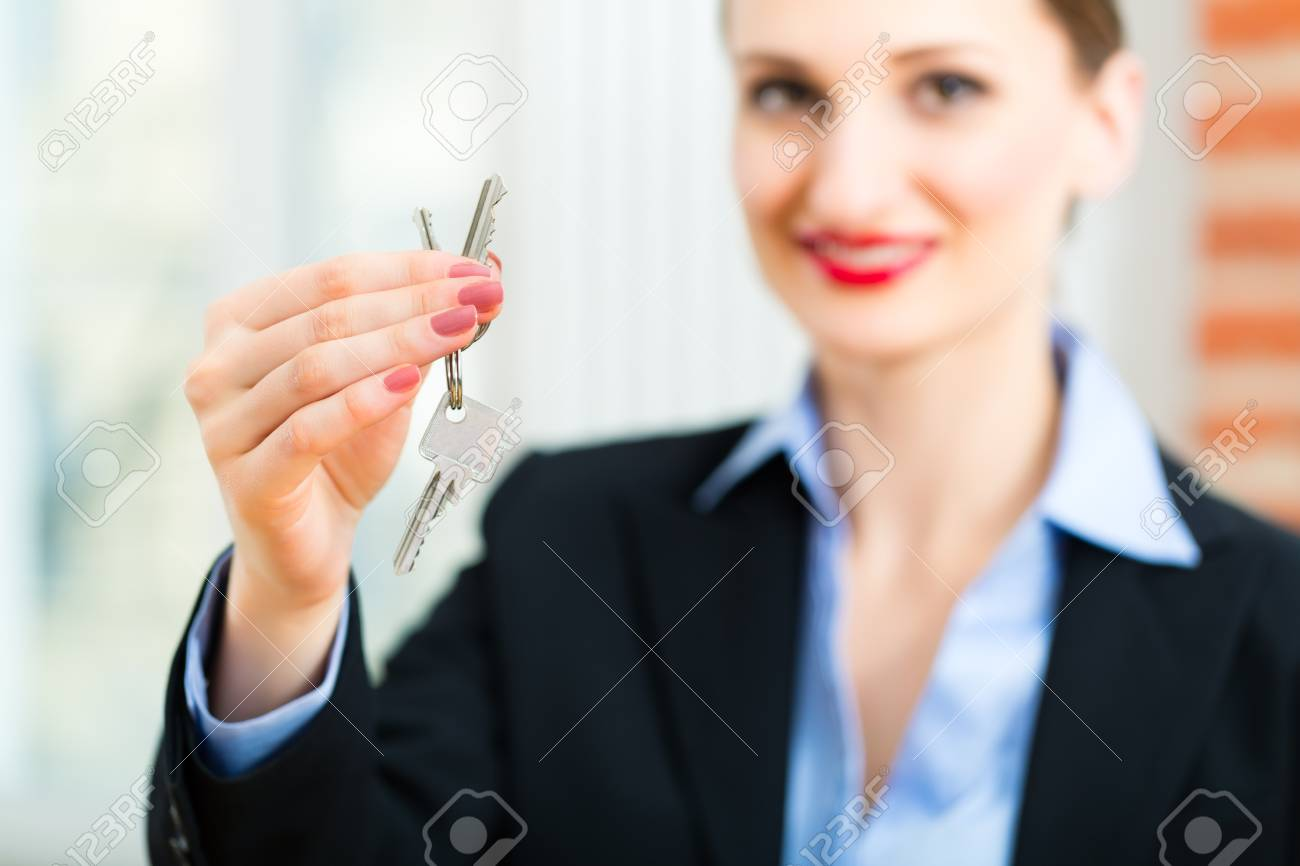 Young realtor is with keys in an apartment, it could be the tenant too Stock Photo - 19226290