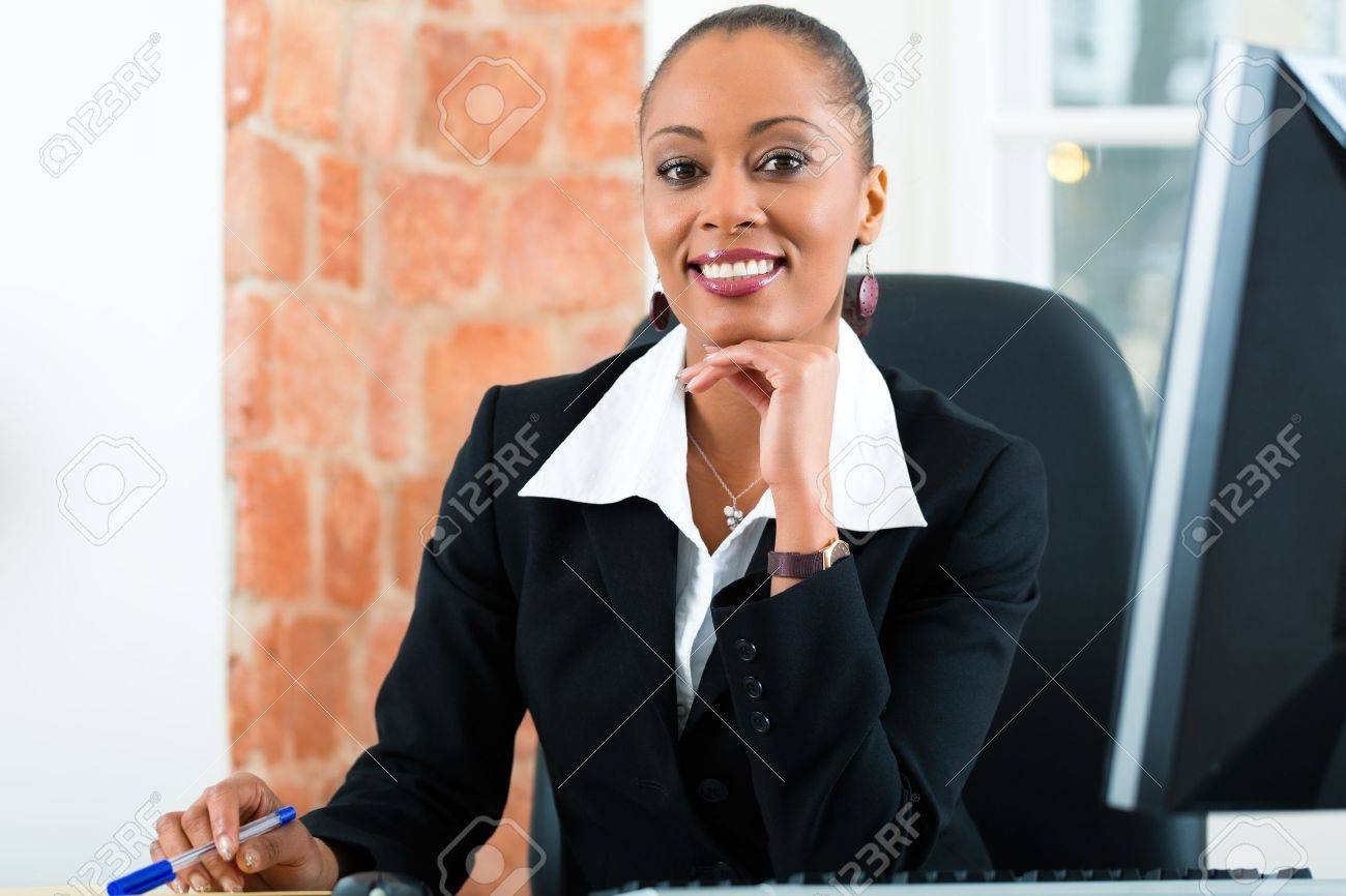 Young female lawyer or paralegal working in her office on a Computer or Pc Stock Photo - 19226060