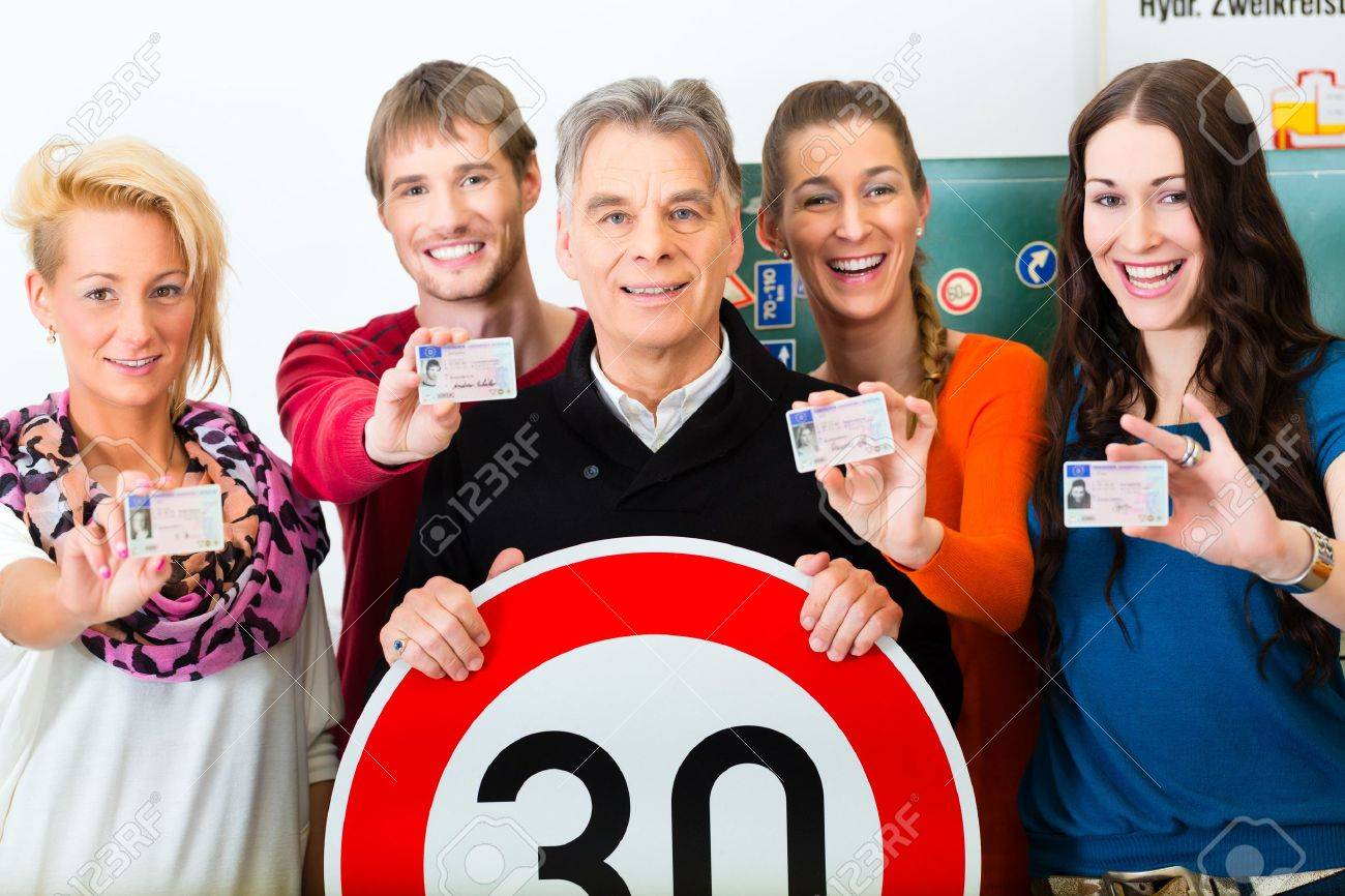 Driving school - driving instructor and student drivers look at a tempo thirty Road sign, in the background are traffic signs Stock Photo - 19226116