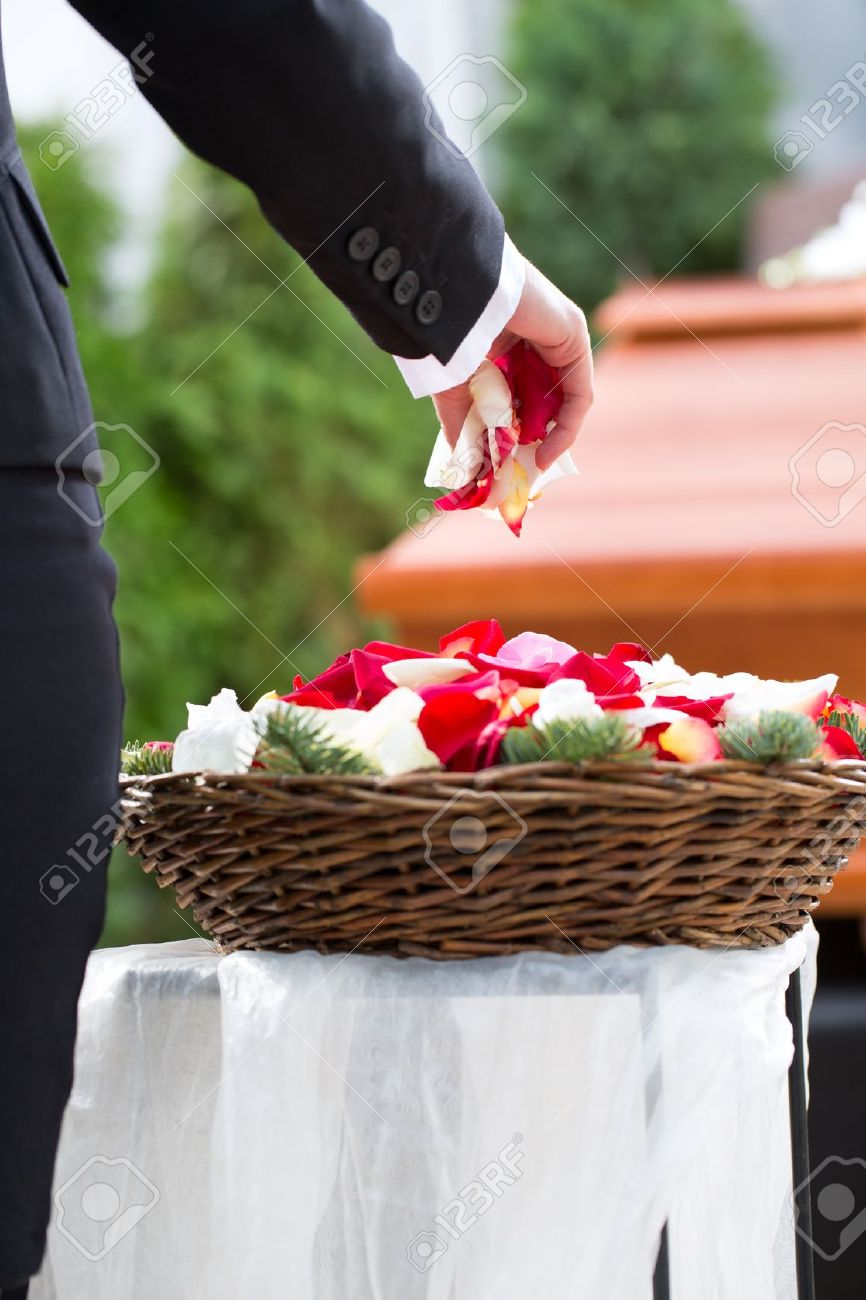Mourning woman on funeral with flowers standing at casket or coffin Stock Photo - 19762000