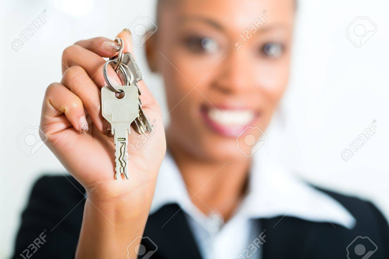 Young realtor with keys in an apartment, it could be the tenant too Stock Photo - 19809451