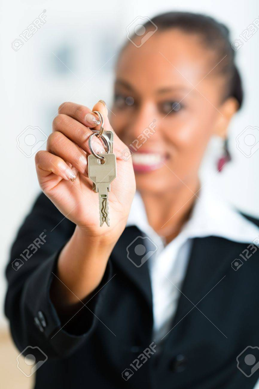 Young realtor with keys in an apartment, it could be the tenant too Stock Photo - 19809463