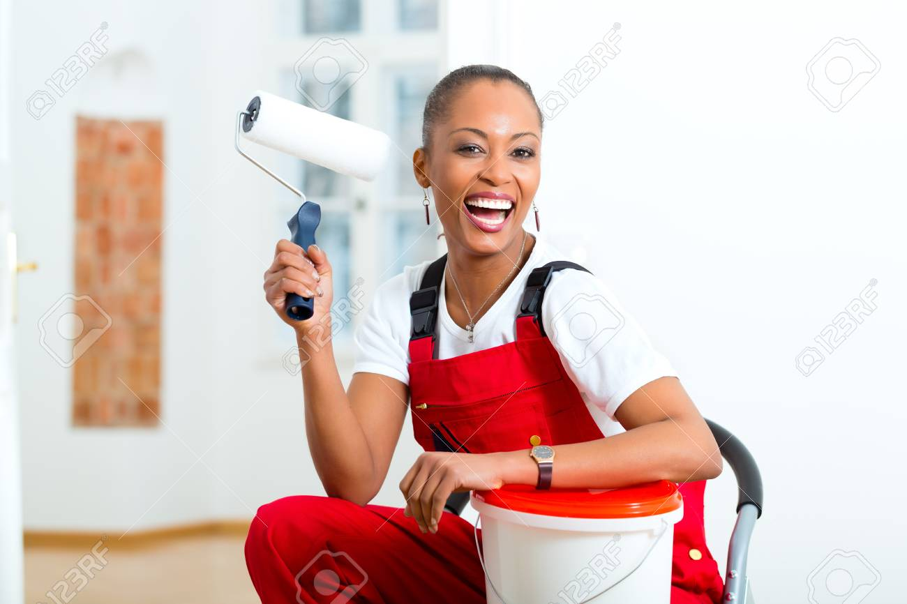 Young woman in overalls renovated because she moved to their new or old home Stock Photo - 19809442