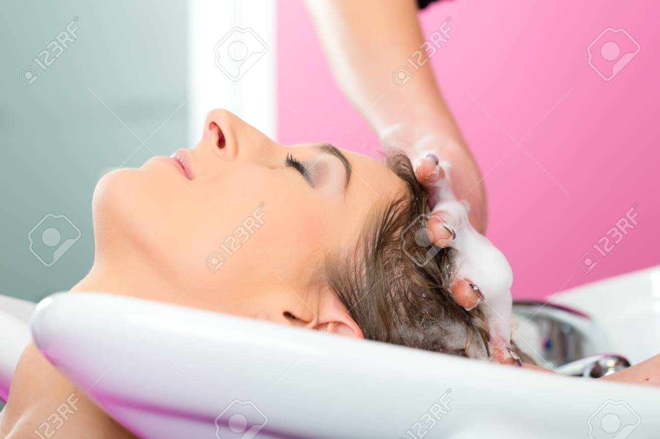 Woman at the hairdresser getting her hair washed and rinsed feeling visibly well Stock Photo - 19915727